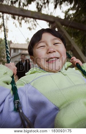 Korean boy swinging