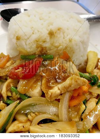 Crop View Stir Mixed Vegetables in Oyster Sauce With Chicken On Steamed Rice