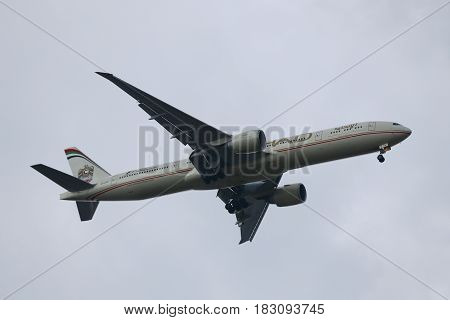 NEW YORK - APRIL 16, 2017: Etihad Airways Boeing 777 descends for landing at JFK International Airport in New York