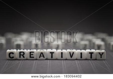 CREATIVITY, by alphabet beads with dark background
