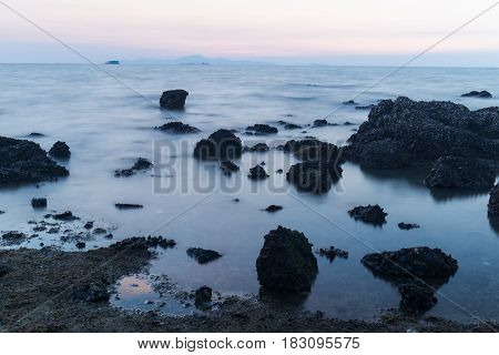 Beautiful Landscape Sunset In The Sea With Stones Rocks On Long Exposure