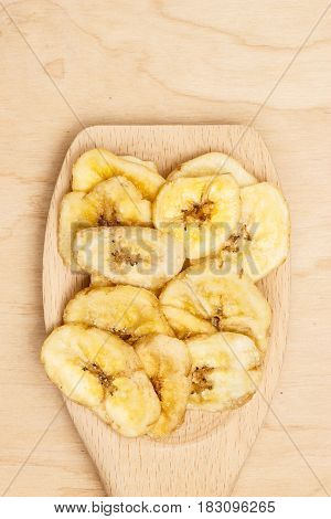 Heap Of Dried Banana Chips On Wooden Spoon