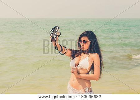 Beautiful Attractive Large Breast Asian Bikini Woman Posing Sexy Portrait On Beach Holding Vintage R