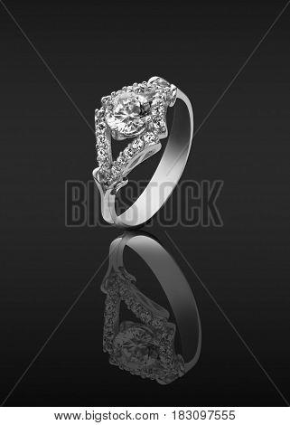women ring with diamonds on dark background