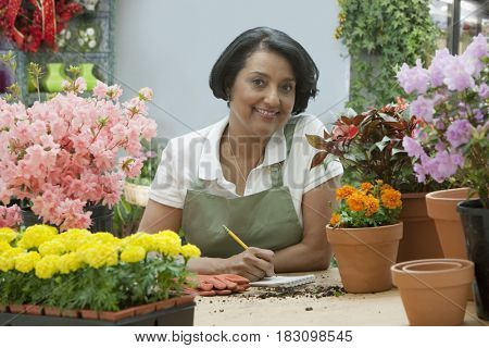 African florist writing on notepad