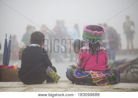 Sa Pa, Vietnam - March 15, 2017: Unidentified Hmong childrens living on the street in Sapa, Vietnam