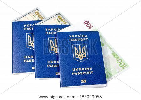 Ukrainian biometric passports with cash notes close-up