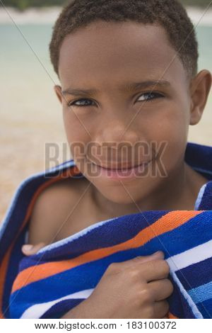 African boy wrapped in beach towel