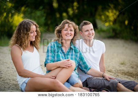 Portrait of a happy family sitting together, closely bonded.