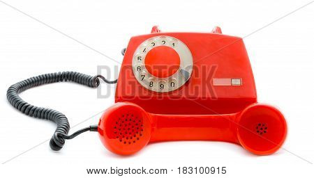 Picture of retro-styled red telephone isolated on white