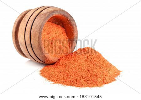 Ground paprika in a wooden bowl isolated on a white background.