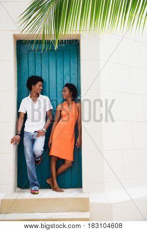 African couple standing in doorway