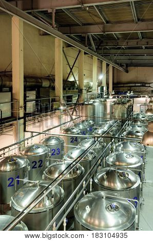 Rows of cisterns from food stainless steel. Brewery, beer fermentation workshop.