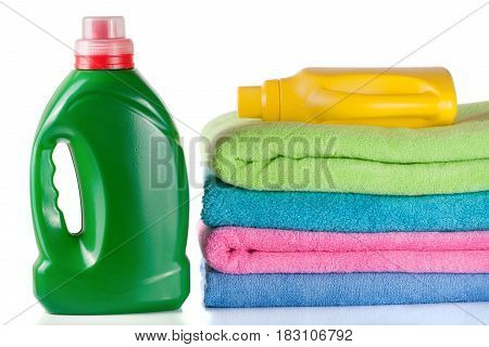 bottle laundry detergent and conditioner with towels isolated on white background.