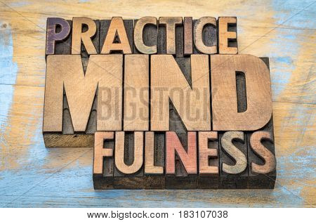 Practice mindfulness - word abstract in vintage letterpress wood type printing blocks