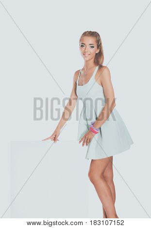 Attractive young woman standing full length portrait