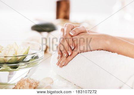 Enjoying Hand And Nail Treatment In Spa.