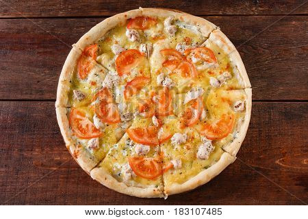 Junk food, bad habits, Pizza sliced on rustic wooden table background, flat lay. Italian cuisine concept.