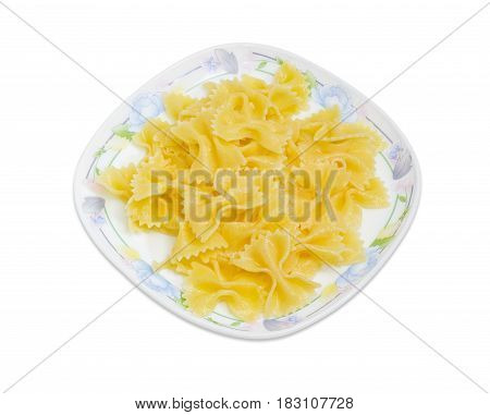Cooked butterfly shaped pasta on the white dish with floral ornament on a light background