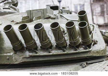 Empty smoke grenades on the tank turret