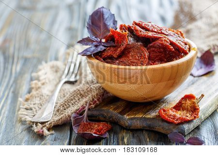 Bowl With Sun-dried Tomatoes And Fork.