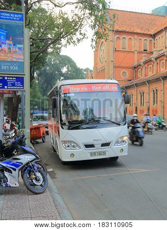HO CHI MINH CITY VIETNAM - NOVEMBER 26, 2016: Tourist sightseeing bus runs in downtown Ho Chi Minh City.