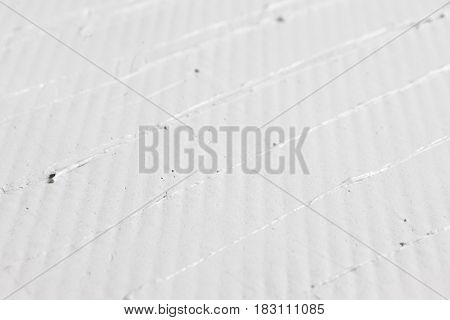 Abstract background of white color plastered wall, close up. Relief stucco structure backdrop with free space for text.