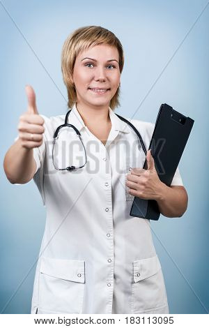 Smiling medical doctor holding a folder over blue background.