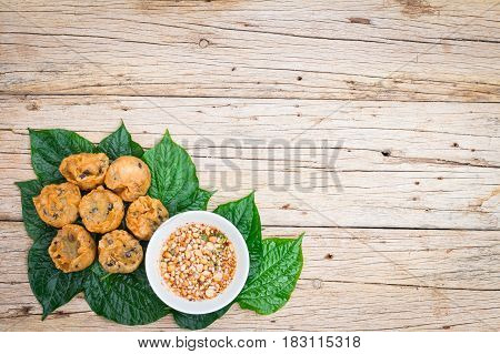 Thai dessert Fried Taro and Black Beans on wooden floor with copy space