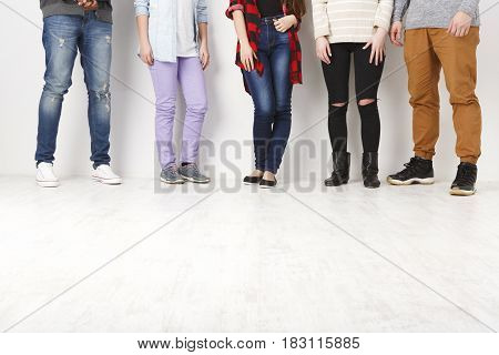 Communication. Crop of diverse informal people standing in row indoors on white studio background