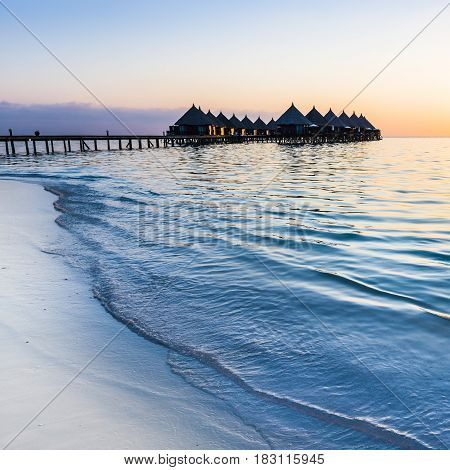 Luxury resort in the Indian Ocean. Relax evening sunset over the ocean. Maldives.