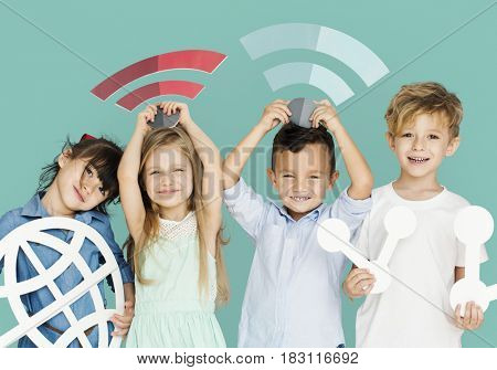 Little Children Holding Technology Symbols