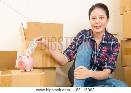 Woman Put Money Cash In Piggy Bank