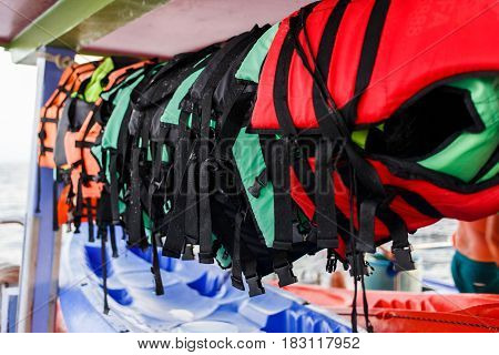 Photo of lifejackets hanging on sea boat