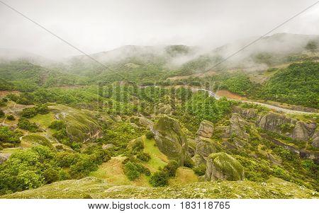 Meteora rocks on the fog after the rain