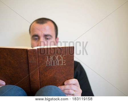 Man Reading Bible On White Background