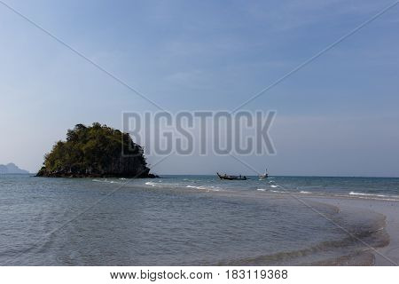Photography of sandy beach, sea and hill