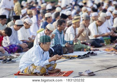 JAKARTA Indonesia. April 18 2017: Asian Muslim people praying to Allah while celebrating Eid Mubarak which marks the end of the month of Ramadan