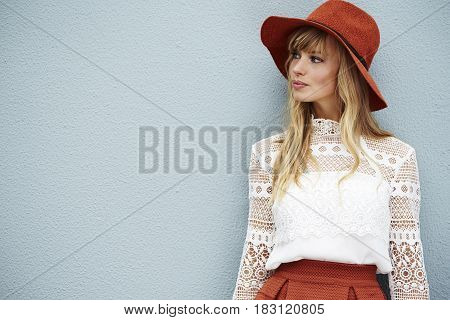 Fashionable young confident model looking away with grey background