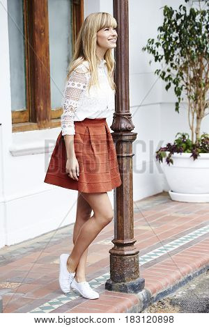Beautiful young woman in skirt and top smiling