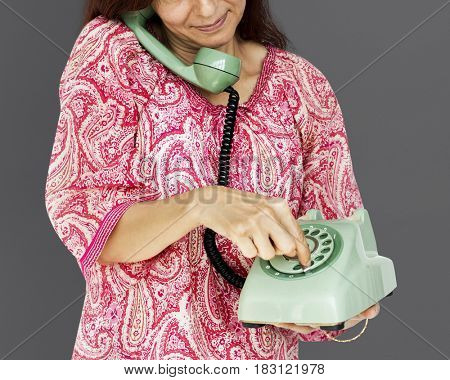 Woman holding and dial telephone communication