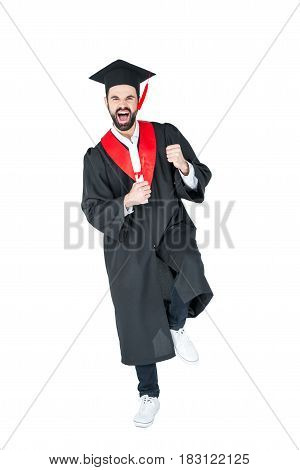 Excited Young Man In Graduation Hat Holding Diploma And Triumphing On White