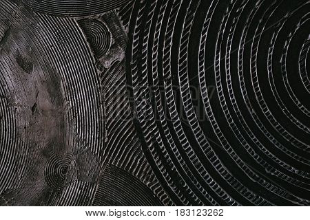 Abstract dark surface covered with circular pattern background