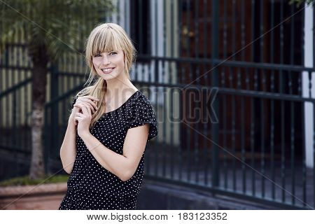 Beautiful woman in spotty dress smiling -streetfashion