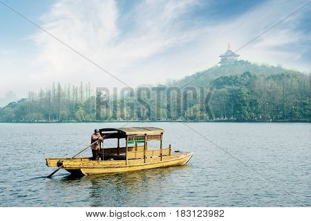 HANGZHOU China. April 18 2017: Picture of wooden boat on the West Lake in Hangzhou China