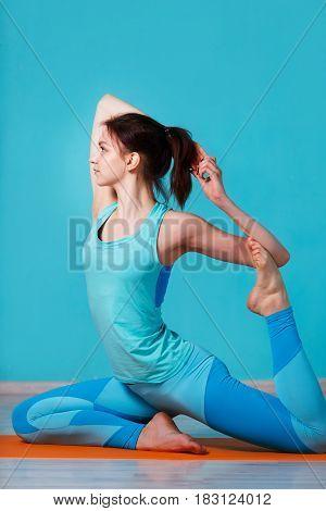 Photo of girl doing yoga in hall