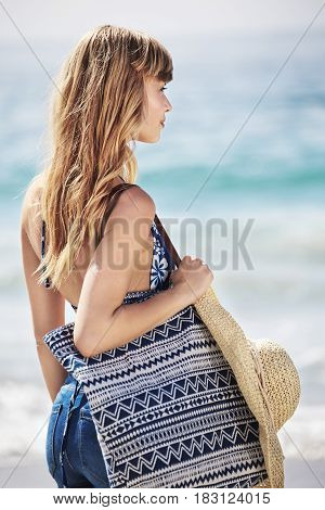 blond beach babe with bag looking away