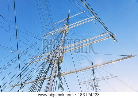 Ship masts in glowing highlights