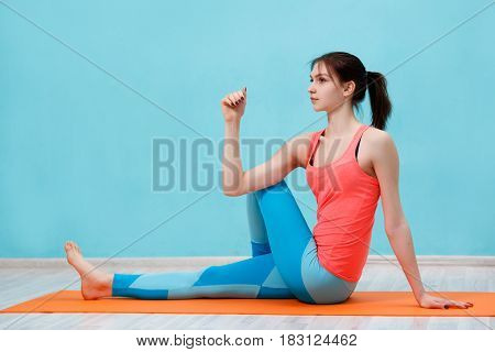 Young athlete engaged in gym on rug