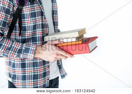 mid section of student holding book isolated on white with copy space